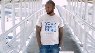 T-Shirt Mockup Video Featuring a Stylish Black Man Waiting on a City Bridge a12876-122016