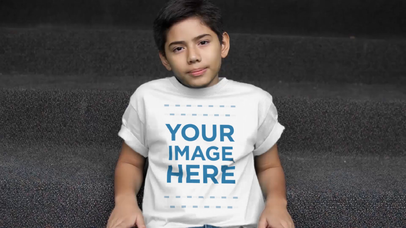 Video Mockup of a Young Boy Sitting on Some Stairs Wearing a Kid's T-Shirt a12770