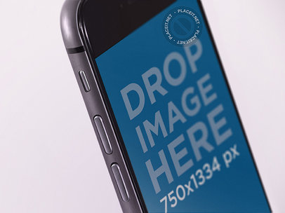 Angled Black iPhone in Portrait Position Close Up Mockup with a White Background b12755