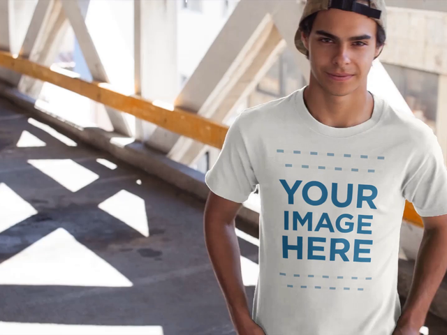 Young Man Wearing a Snapback Hat and Round Neck Tee Mockup Video in a Parking Lot a12867