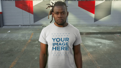 Young Man Standing in a Parking Lot Wearing a Round Neck Tee Video Mockup a12237-122016