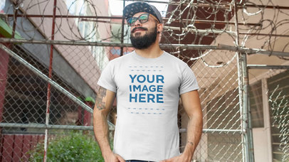 Guy with a Beard and Snapback Hat Wearing a Round Neck T-Shirt Video Mockup a12261-121916