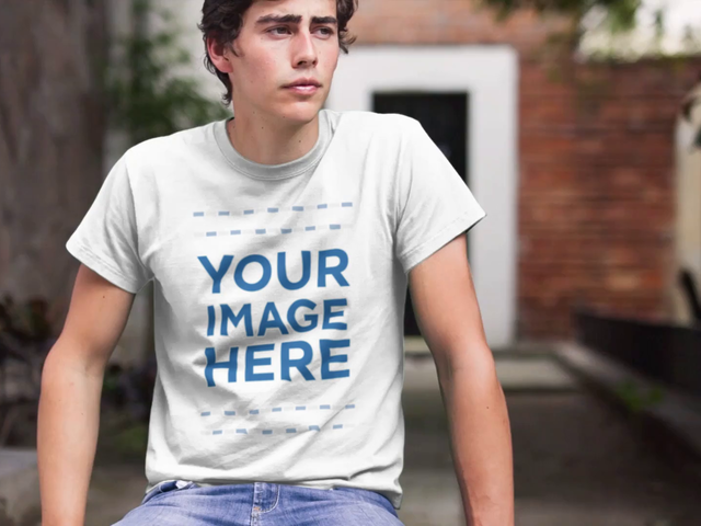 T-Shirt Mockup Video of a Trendy Young Man Sitting in a Park a12135-121916