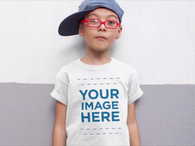 Young Boy with a Hat Wearing a Kid's Round Neck Tee Video Mockup a12543