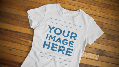 Round Neck Tee Video Mockup of a T-Shirt Extended Over a Wooden Surface a13093-122316