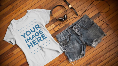Round Neck Tee Video Mockup of a T-Shirt with a Watch and Shorts Outfit Over a Wooden Table a13092-122316