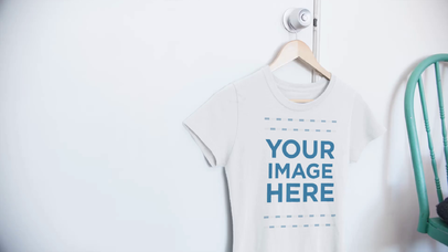 T-Shirt Video Mockup Featuring a Round Neck Tee Hanging on a Closet Door in a Bedroom a13083-122316