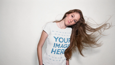 Lovely Young Woman Playing with her Hair in a Photoshoot T-Shirt Video Mockup a13303-122616