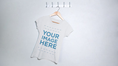 Round Neck Tee Swinging From Side to Side on a Hanger Mockup Video a13277-122616