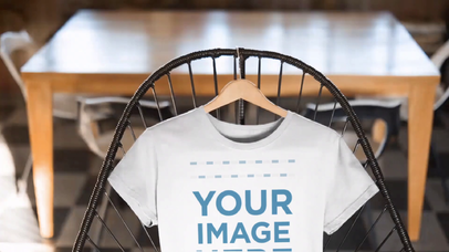 Closeup T-Shirt Mockup Video of a Round Neck Tee on a Cool Chair a13136-122616