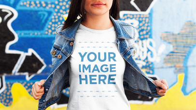 Video Mockup of a Young Trendy Girl Wearing a Hat and Round Neck Tee with Denim Jacket Near a Graffiti Wall a13365-122716