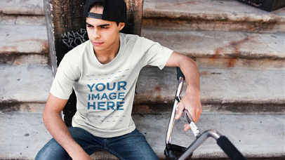Trendy Guy with his Bike Wearing a Hat and Round Neck Tee Video Mockup a13356-122716