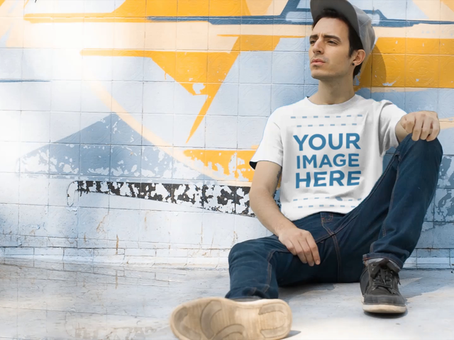 Skater Guy Sitting at the Skate Park Wearing a Round Neck Tee Mockup Video a12861-122716