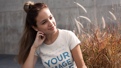 Apparel Mockup Video of a Trendy Girl with a Hair Bun Wearing a Round Neck Tee Outdoors  a13238-122816