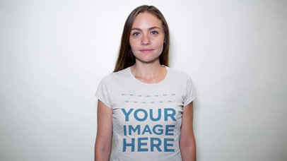 Lovely Woman Wearing a Round Neck T-Shirt in a Studio Mockup Video a13313-122816