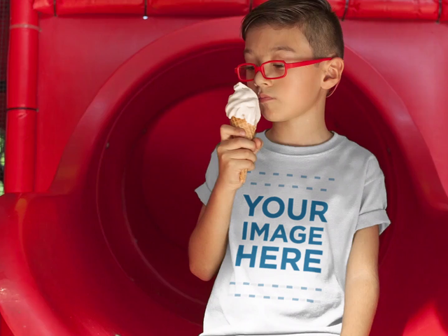 Kid's Tee Mockup Video of a Little Boy Eating an Ice Cream Cone at the Park a12540-122716