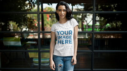 Apparel Video Mockup of a Short Haired Girl Wearing a T-Shirt Outside With a Window Behind Her a13437