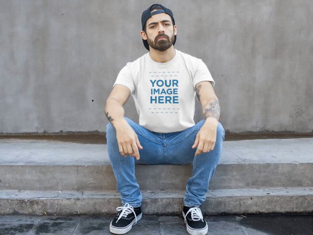 Serious Man Wearing a T-Shirt Sitting Down in Stairs Mockup Video 12173