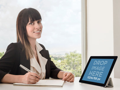 Business Woman Using An iPad At Office