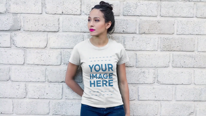 Mockup Video of a Pretty Girl With a Hair Bun Using her T-Shirt Against a White Bricks Wall 12828