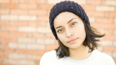 Young Girl Wearing a Round Neck T-Shirt and a Beanie Outdoors Apparel Video Mockup a13585