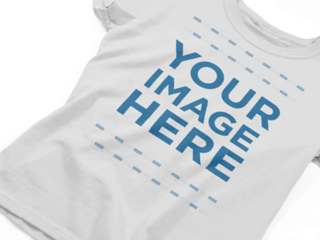 Video Mockup Hovering Over a Girl's T-Shirt on a Flat Surface a12350