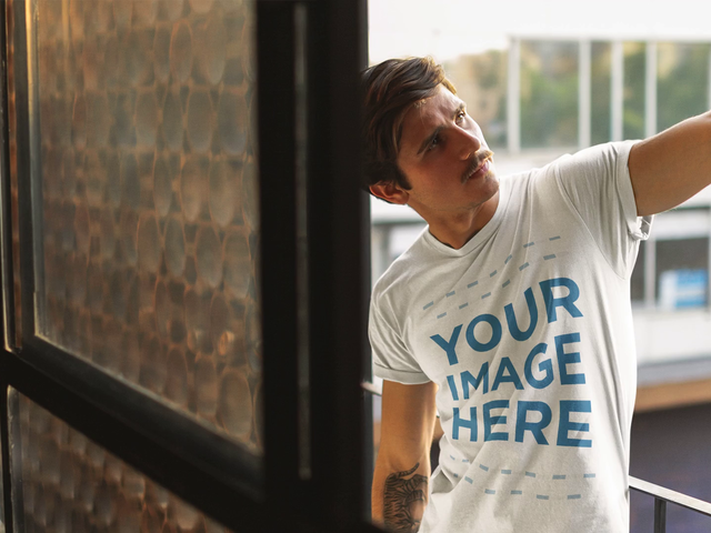 Stop Motion Video Mockup of a Hipster White Man Wearing a T-Shirt at a Balcony a13528