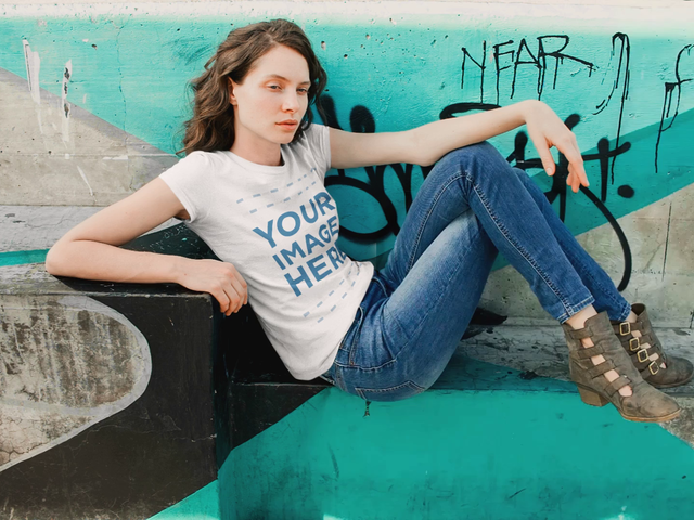 Mockup Video of a White Girl Sitting Down on a Skating Park While Wearing a T-Shirt a13536