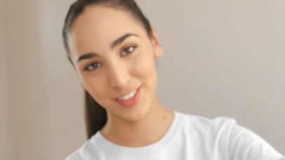 Smiling Pretty Girl Wearing a T-Shirt at a House Video Mockup a13337