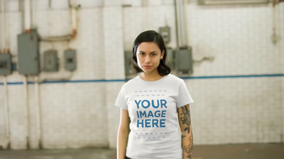 Edgy Girl Wearing a Round Neck Tee at a Warehouse Mockup Videoa13376