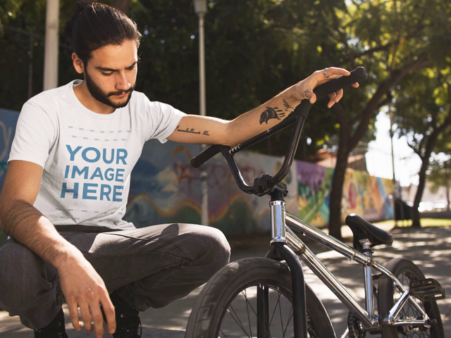 Video Mockup Cinemagraph of a Trendy Young Man With His Bicycle a13369
