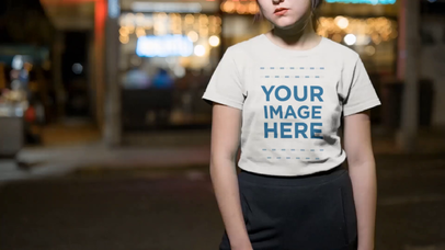 Video Mockup of an Edgy Asian Girl in the City at Night Wearing a T-Shirt a13067