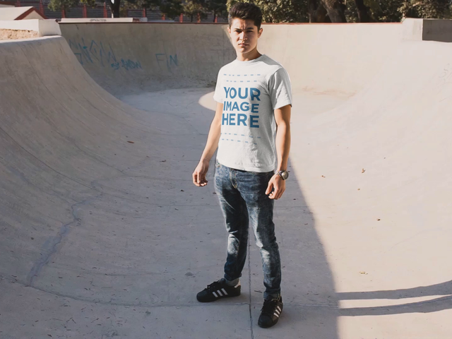 Mockup Cinemagraph of a Young Man Wearing a T-Shirt in a Skating Park With Moving Skate a13499