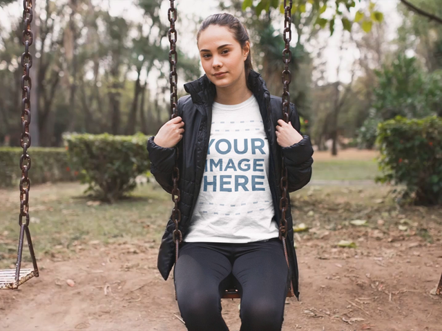 Pretty Girl Sitting Down in a Park's Hammock While Man Running Behind Cinemagraph Video a13540