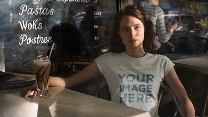 Cinemagraph Video Mockup of a Pretty Girl Using a Round Neck Tee While Having a Frapuccino at a Bar a13537