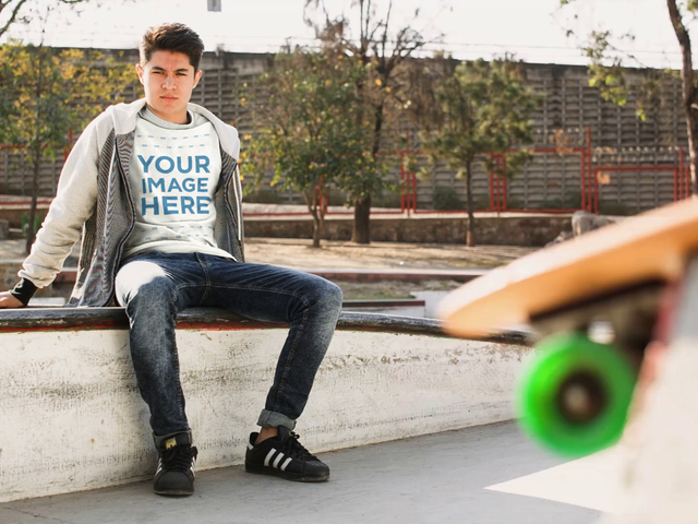 Cinemagraph Mockup of a Young White Man at a Skating Park Wearing a Tee While Skate Wheels Roll a13500