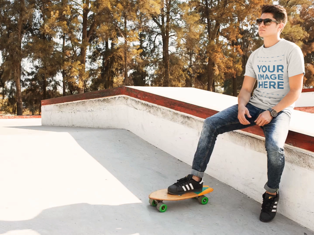 Young Man Outdoors Playing With a Skate While Wearing a T-Shirt Cinemagraph Mockup a13501