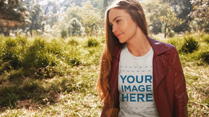 Cinemagraph Mockup of a Young Girl Wearing a T-Shirt and Leather Jacket While Sitting Outdoors a13309