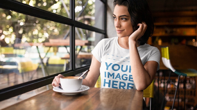 Young Girl Having a Coffee at a Cafe While Wearing a Round Neck Tee Cinemagraph Mockup a13442