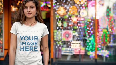 Cinemagraph Mockup of a Young Girl Wearing a Round Neck T-Shirt In Front of a Store With Flashing Lights a13323