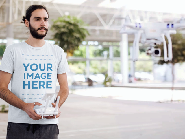 Young Man Playing With a Helicopter While Using a Round Neck Tee Cinemagraph Mockup 13367
