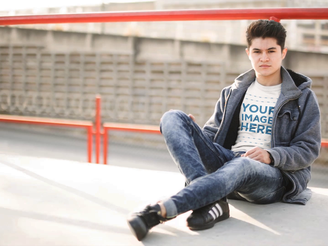 Cinemagraph Mockup of a Young White Man Sitting Down in a Urban Environment While Wearing a Round Neck Tee a13496bb
