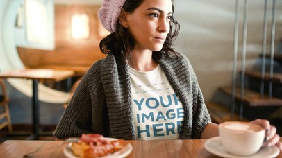 Pretty Girl Having a Latte at a Coffee Wearing a Round Neck Tee Cinemagraph Mockup a13443