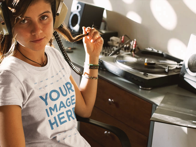 Young Girl Listening to a Vinyl Record Wearing a Round Neck T-Shirt Cinemagraph Mockup a13322