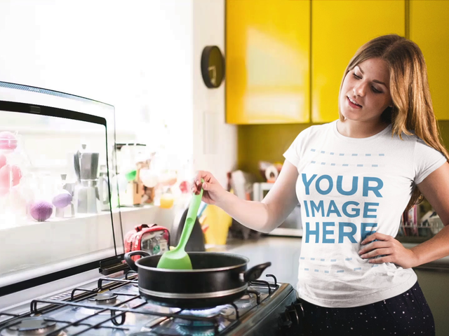 Cinemagraph Mockup of a Pretty Young Girl Cooking in Her Kitchen Wearing a Round Neck T-Shirt b13479