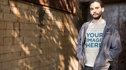 Young Man Wearing a Round Neck Tee and a Hoodie Under the Shadow of a Tree Cinemagraph Mockup b13445