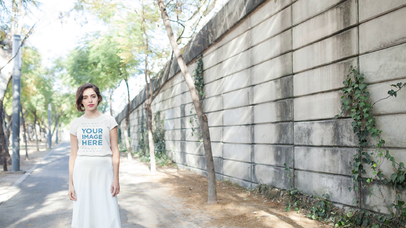 Stop Motion Mockup of a Pretty Lady Wearing a Round Neck T-Shirt and a Long Skirt b13596