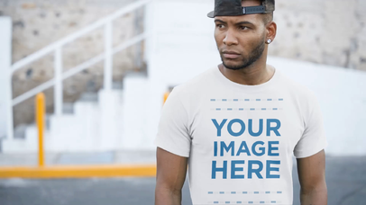 Trendy Black Man Wearing a T-Shirt in an Urban Environment Apparel Video Mockup a13509