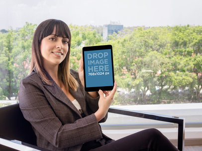 Business Woman Showcasing An iPad At The Office