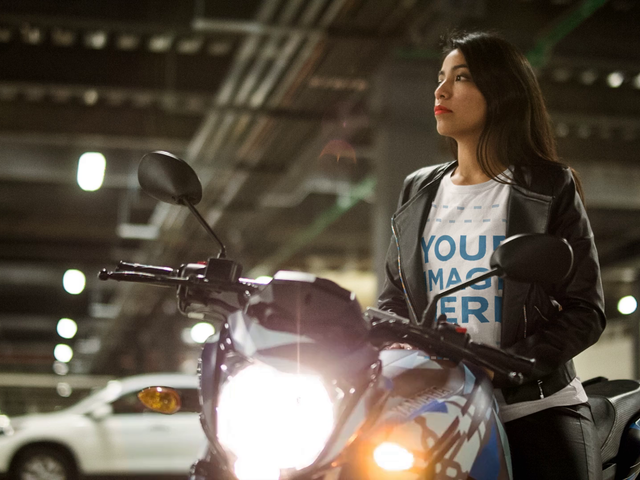 Mockup Cinemagraph of a Young Lady Wearing a Round Neck T-Shirt and a Leather Jacket While Sitting on her Motorcycle With Flashing Lights a13578